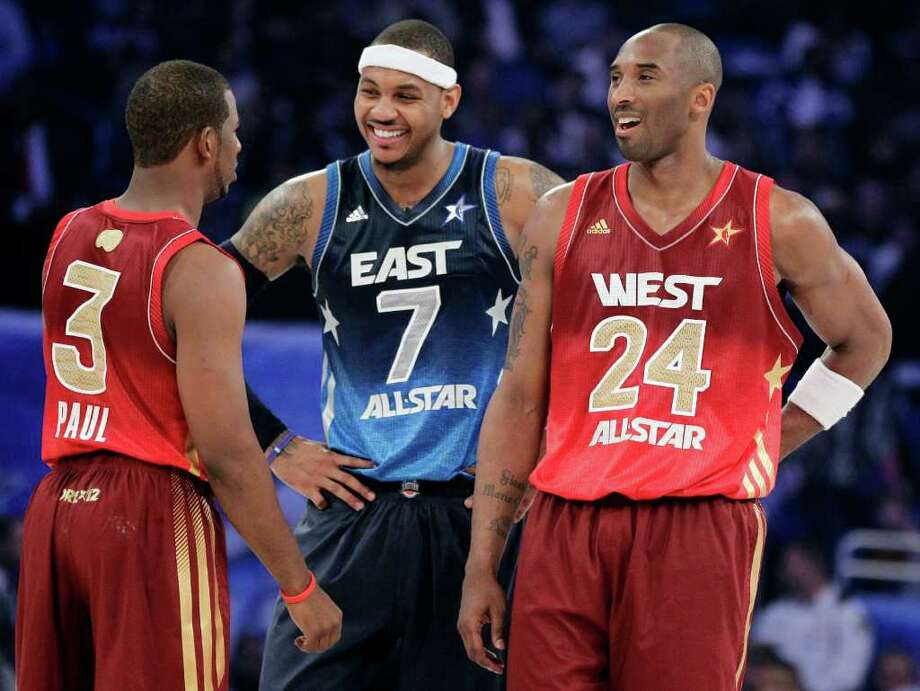 Western Conference's Chris Paul (3), of the Los Angeles Clippers, Eastern Conference's Carmelo Anthony (7), of the New York Knicks, and Western Conference's Kobe Bryant (24), of the Los Angeles Lakers, talk before the NBA All-Star basketball game, Sunday, Feb. 26, 2012, in Orlando, Fla. (AP Photo/Chris O'Meara) Photo: Associated Press