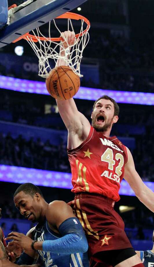 Western Conference's Kevin Love (42), of the Minnesota Timberwolves, dunks on Eastern Conference's Dwight Howard (12), of the Orlando Magic, during the first half of the NBA All-Star basketball game, Sunday, Feb. 26, 2012, in Orlando, Fla. (AP Photo/Chris O'Meara) Photo: Associated Press