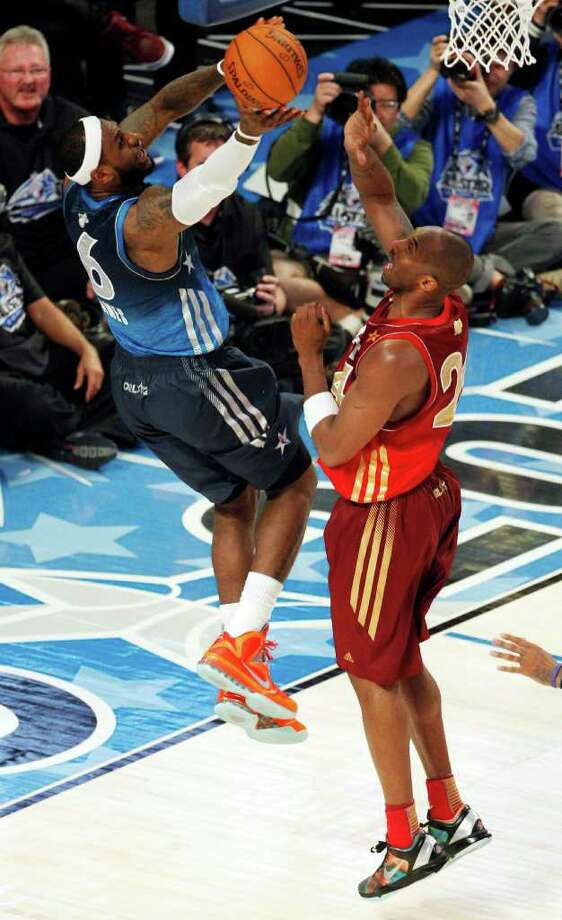 Eastern Conference's LeBron James (6), of the Miami Heat, shoots against Western Conference's Kobe Bryant (24), of the Los Angeles Lakers, during the first half of the NBA All-Star basketball game, Sunday, Feb. 26, 2012, in Orlando, Fla. (AP Photo/Lynne Sladky) Photo: Associated Press