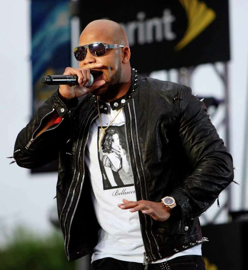 Rapper Flo Rida performs before the NBA All-Star basketball game, Sunday, Feb. 26, 2012, in Orlando, Fla. (AP Photo/Lynne Sladky) Photo: Associated Press