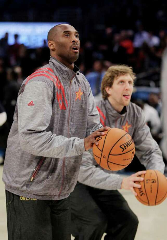 Western Conference's Kobe Bryant, of the Los Angeles Lakers, left, and Dirk Nowitzki, of the Dallas Mavericks, warm up before the NBA All-Star basketball game, Sunday, Feb. 26, 2012, in Orlando, Fla. (AP Photo/Chris O'Meara) Photo: Associated Press