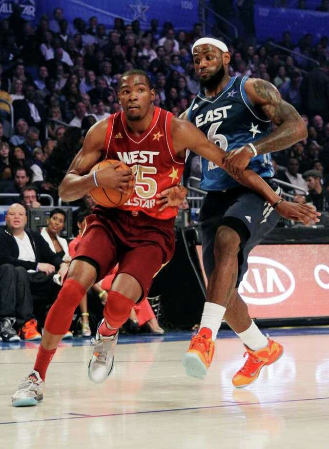 Eastern Conference's LeBron James (6), of the Miami Heat, pressures Western Conference's Kevin Durant (35), of the Oklahoma City Thunder, during the NBA All-Star basketball game, Sunday, Feb. 26, 2012, in Orlando, Fla. (AP Photo/Chris O'Meara) Photo: Associated Press