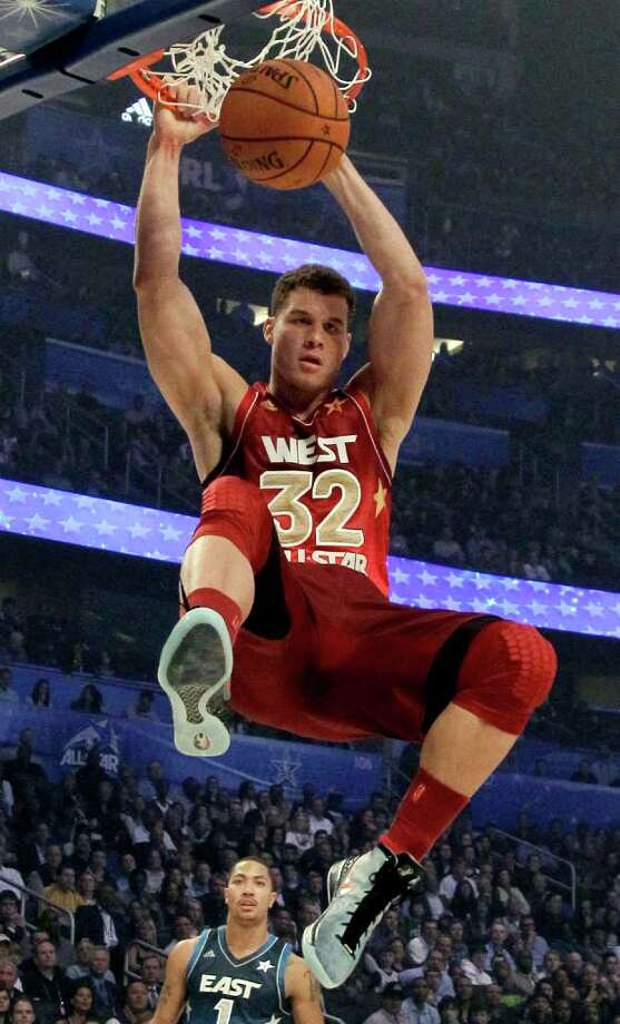 Western Conference's Blake Griffin (32), of the Los Angeles Clippers, dunks the ball during the NBA All-Star basketball game, Sunday, Feb. 26, 2012, in Orlando, Fla. (AP Photo/Chris O'Meara) Photo: Associated Press