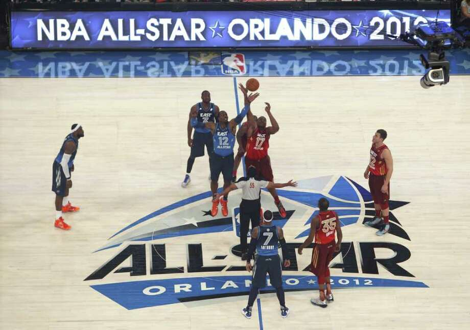 Eastern Conference's Dwight Howard (12), of the Orlando Magic, and Western Conference's Andrew Bynum (17), of the Los Angeles Lakers, reach for the opening tip at the NBA All-Star basketball game, Sunday, Feb. 26, 2012, in Orlando, Fla. (AP Photo/Lynne Sladky) Photo: Associated Press