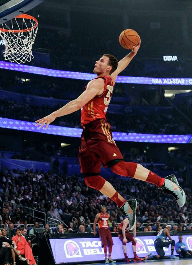 Western Conference's Blake Griffin (32), of the Los Angeles Clippers, dunks the ball during the first half of the NBA All-Star basketball game, Sunday, Feb. 26, 2012, in Orlando, Fla. (AP Photo/Chris O'Meara) Photo: Associated Press
