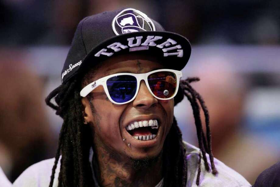 Rapper Lil Wayne watches the first half of the NBA All-Star basketball game, Sunday, Feb. 26, 2012, in Orlando, Fla. (AP Photo/Chris O'Meara) Photo: Associated Press