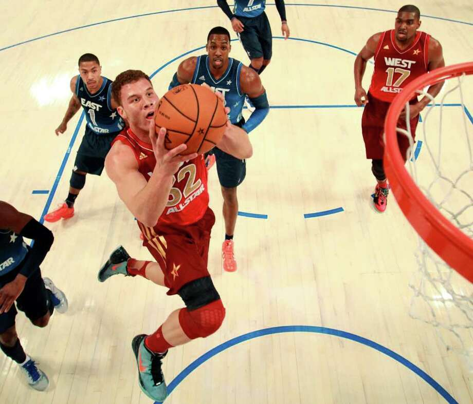 Western Conference's Blake Griffin (32), of the Los Angeles Clippers, dunks the ball past Eastern Conference's Derrick Rose (1), of the Chicago Bulls, Dwight Howard (12), of the Orlando Magic, and Western Conference's Andrew Bynum (17), of the Los Angeles Lakers, during the first half of the NBA All-Star basketball game, Sunday, Feb. 26, 2012, in Orlando, Fla. (AP Photo/Ronald Martinez, Pool) Photo: Associated Press