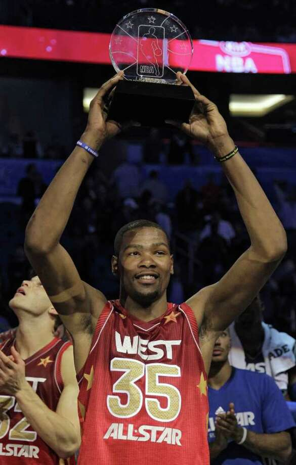 Western Conference's Kevin Durant, of the Oklahoma City Thunder, hoists the Most Valuable Player trophy following the NBA All-Star basketball game, Sunday, Feb. 26, 2012, in Orlando, Fla. The Western Conference won 152-149. (AP Photo/Chris O'Meara) Photo: Associated Press
