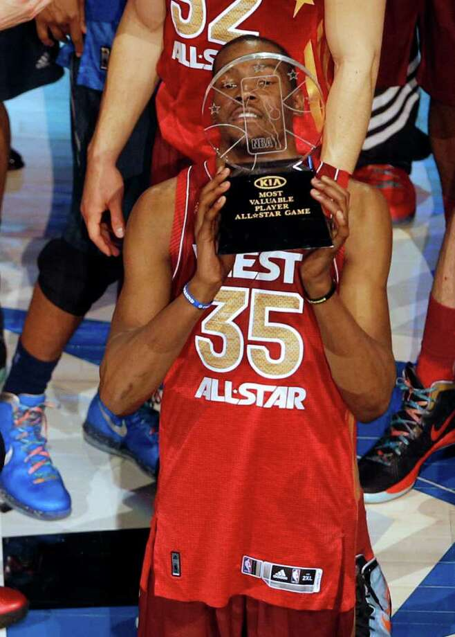 Western Conference's Kevin Durant, of the Oklahoma City Thunder, hoists the Most Valuable Player trophy following the NBA All-Star basketball game, Sunday, Feb. 26, 2012, in Orlando, Fla. The Western Conference won 152-149. (AP Photo/Lynne Sladky) Photo: Associated Press