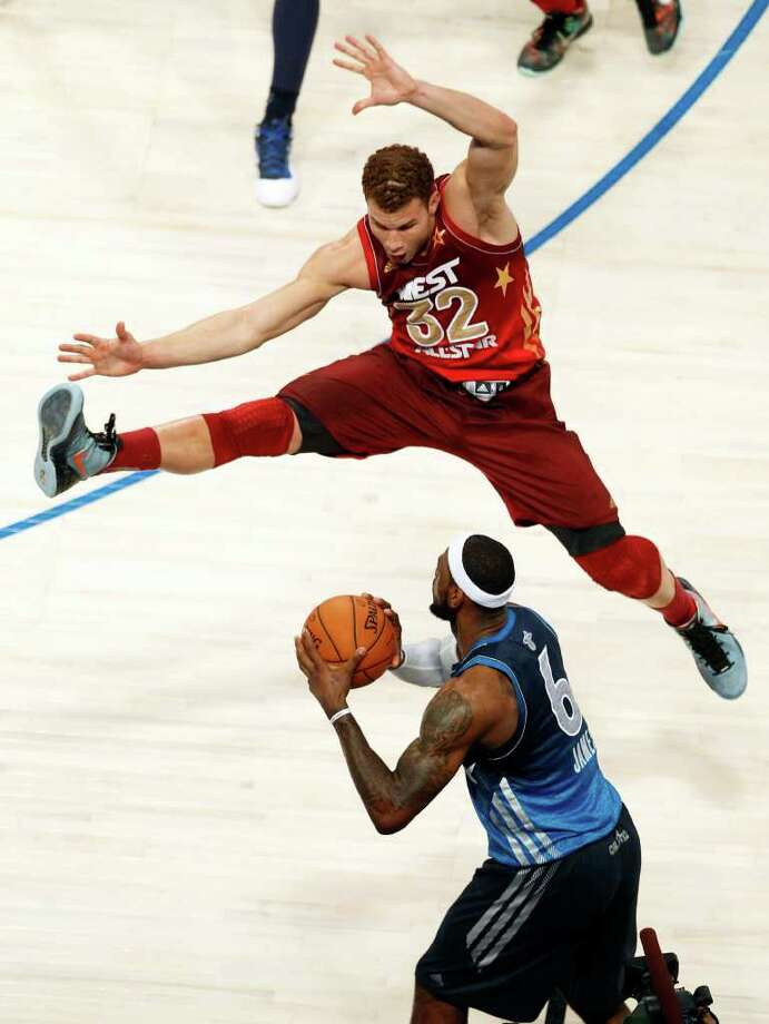 Western Conference's Blake Griffin (32), of the Los Angeles Clippers, jumps to block a pass by Eastern Conference's LeBron James (6), of the Miami Heat, during the NBA All-Star basketball game, Sunday, Feb. 26, 2012, in Orlando, Fla. The Western Conference won 152-149. (AP Photo/Lynne Sladky) Photo: Associated Press