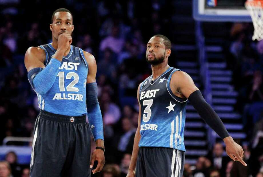 Eastern Conference's Dwight Howard (12), of the Orlando Magic, and Dwyane Wade (3), of the Miami Heat, talk at midcourt during the second half of the NBA All-Star basketball game, Sunday, Feb. 26, 2012, in Orlando, Fla. The Western Conference won 152-149. (AP Photo/Chris O'Meara) Photo: Associated Press