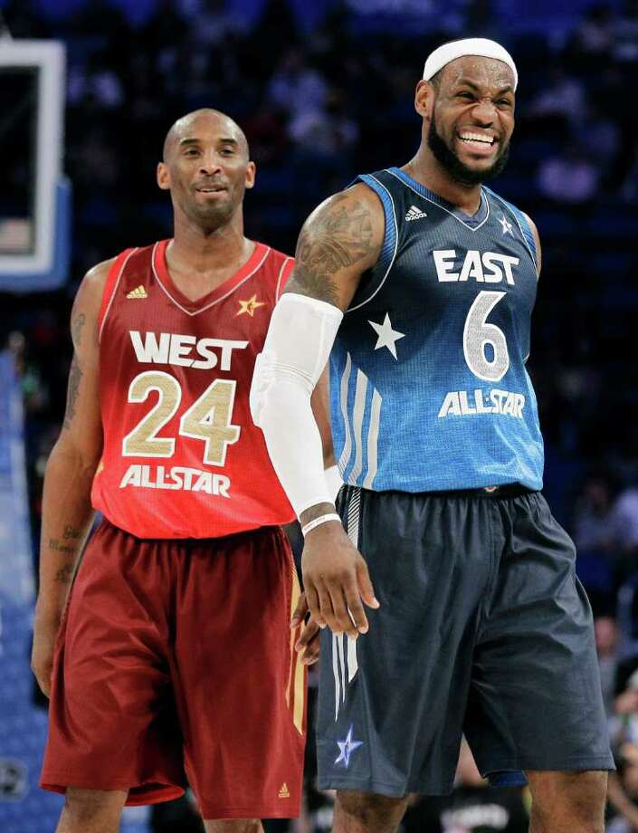 Eastern Conference's LeBron James (6), of the Miami Heat, laughs with Western Conference's Kobe Bryant (24), of the Los Angeles Lakers, during the fourth quarter of the NBA All-Star basketball game, Sunday, Feb. 26, 2012, in Orlando, Fla. The Western Conference won 152-149. (AP Photo/Chris O'Meara) Photo: Associated Press