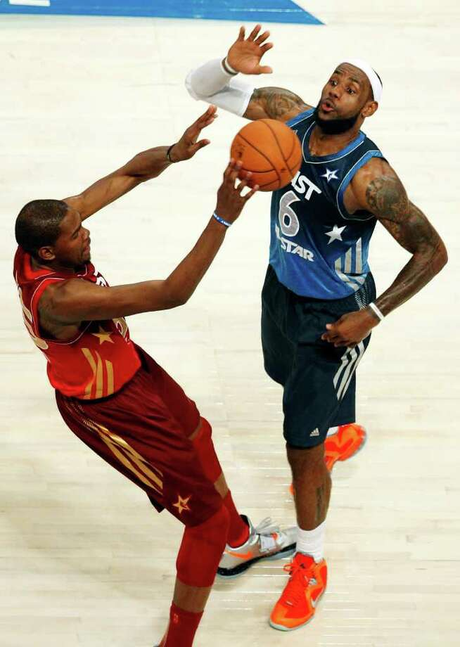 Western Conference's Kevin Durant, left, of the Oklahoma City Thunder, passes the ball around Eastern Conference's LeBron James (6), of the Miami Heat, in the second half of the NBA All-Star basketball game, Sunday, Feb. 26, 2012, in Orlando, Fla. The Western Conference won 152-149. (AP Photo/Lynne Sladky) Photo: Associated Press