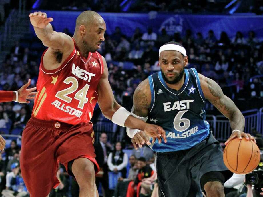 Eastern Conference's LeBron James (6), of the Miami Heat, right, drives around Western Conference's Kobe Bryant (24), of the Los Angeles Lakers, during the fourth quarter of the NBA All-Star basketball game, Sunday, Feb. 26, 2012, in Orlando, Fla. The Western Conference won 152-149. (AP Photo/Chris O'Meara) Photo: Associated Press