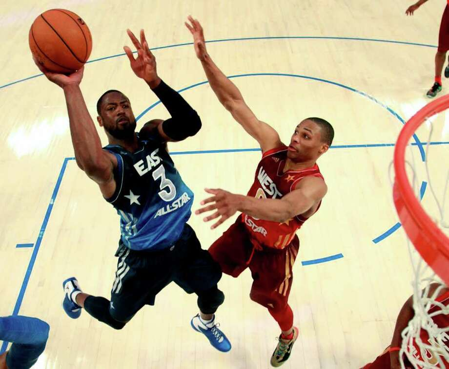 Eastern Conference's Dwyane Wade (3), of the Miami Heat, shoots against Western Conference's Russell Westbrook (0), of the Oklahoma City Thunder, during the second half of the NBA All-Star basketball game, Sunday, Feb. 26, 2012, in Orlando, Fla. The Western Conference won 152-149. (AP Photo/Ronald Martinez, Pool) Photo: Associated Press