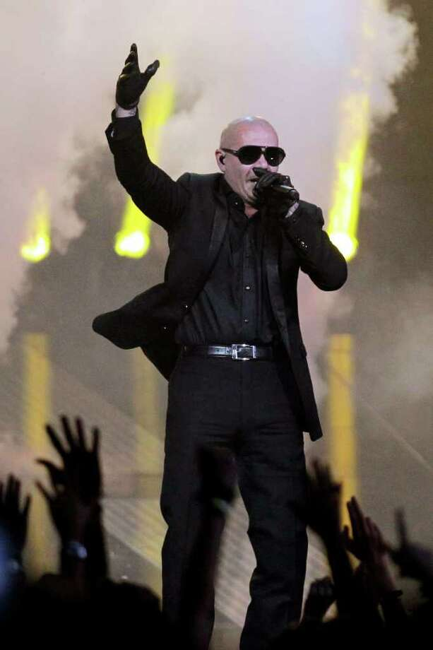 Rapper Pitbull performs during the halftime show of the NBA All-Star basketball game, Sunday, Feb. 26, 2012, in Orlando, Fla. (AP Photo/Chris O'Meara) Photo: Associated Press