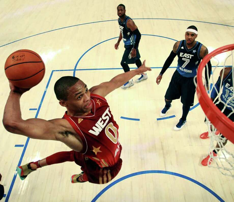 Western Conference's Russell Westbrook (0), of the Oklahoma City Thunder, goes for a dunk past Eastern Conference's Dwyane Wade (3), of the Miami Heat, and Carmelo Anthony (7), of the New York Knicks, during the first half of the NBA All-Star basketball game, Sunday, Feb. 26, 2012, in Orlando, Fla. (AP Photo/Ronald Martinez, Pool) Photo: Associated Press
