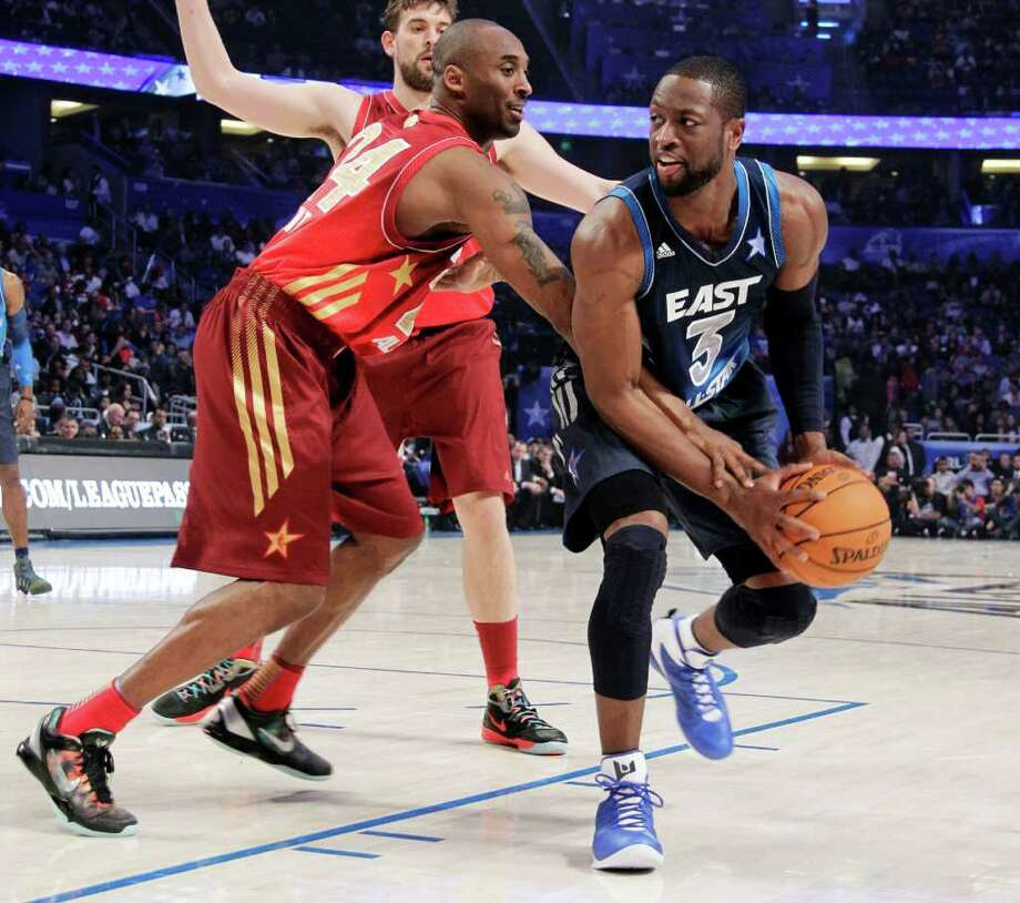 Eastern Conference's Dwyane Wade (3), of the Miami Heat, looks to pass as Western Conference's Kobe Bryant (24), of the Los Angeles Lakers, defends during the second half of the NBA All-Star basketball game, Sunday, Feb. 26, 2012, in Orlando, Fla. (AP Photo/Chris O'Meara) Photo: Associated Press