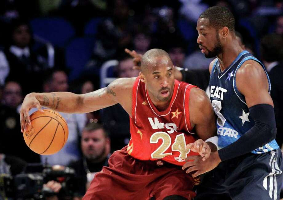 Eastern Conference's Dwyane Wade (3), of the Miami Heat, defends Western Conference's Kobe Bryant (24), of the Los Angeles Lakers, during the second half of the NBA All-Star basketball game, Sunday, Feb. 26, 2012, in Orlando, Fla. The Western Conference won 152-149. (AP Photo/Chris O'Meara) Photo: Associated Press