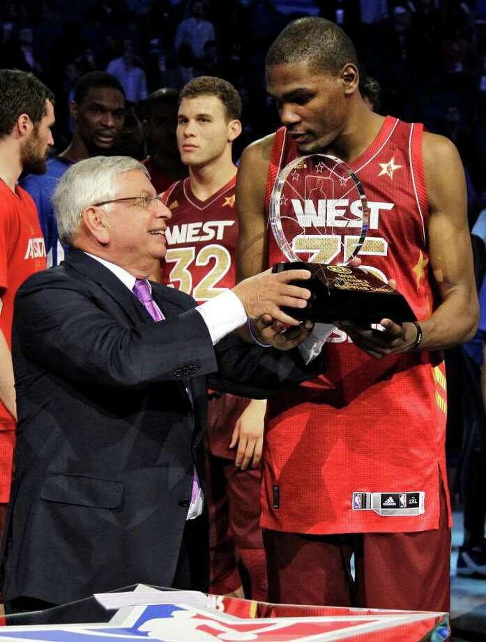 Commissioner David Stern presents the Most Valuable Player trophy to Western Conference's Kevin Durant (35), of the Oklahoma City Thunder, after the NBA All-Star basketball game, Sunday, Feb. 26, 2012, in Orlando, Fla. The Western Conference won 152-149. (AP Photo/Chris O'Meara) Photo: Associated Press