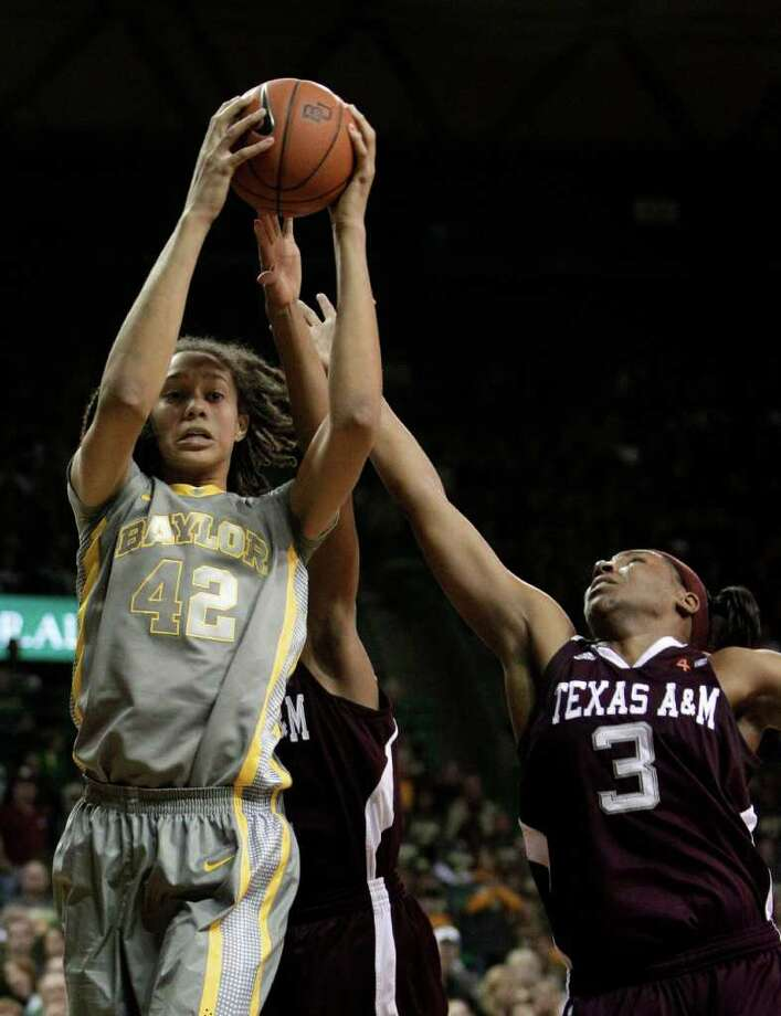 Baylor's Brittney Griner (42) dominated the last time the Lady Bears met Kelsey Bone (3) and the Aggies. Photo: Tony Gutierrez / AP