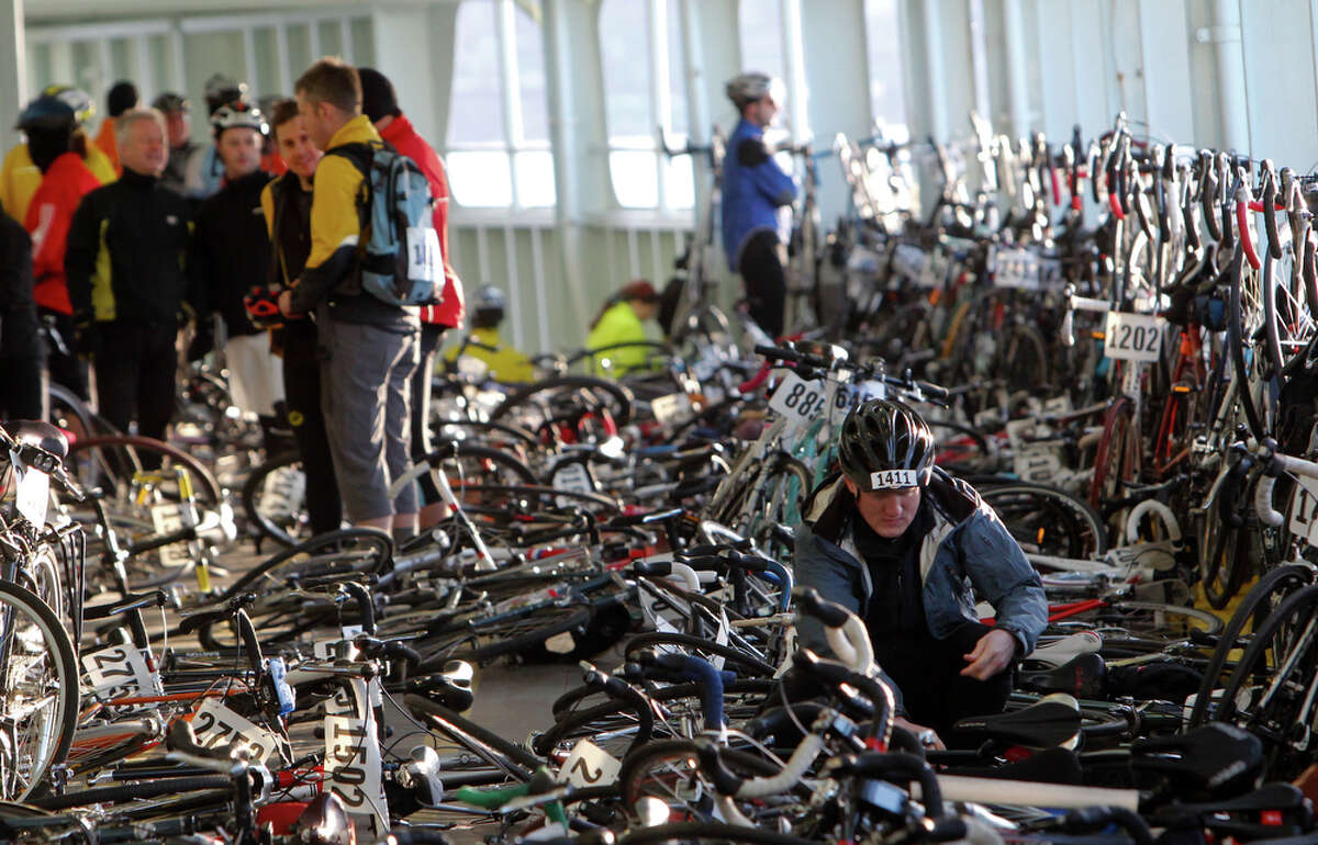 People prepare for the Chilly Hilly bike ride on the ferry from Seattle to Bainbridge Island on Sunday Feb. 26, 2012. The Cascade Bicycle Club organizes the ride to encourage cyclists to stay active during the winter months and to support Bainbridge Island charities.