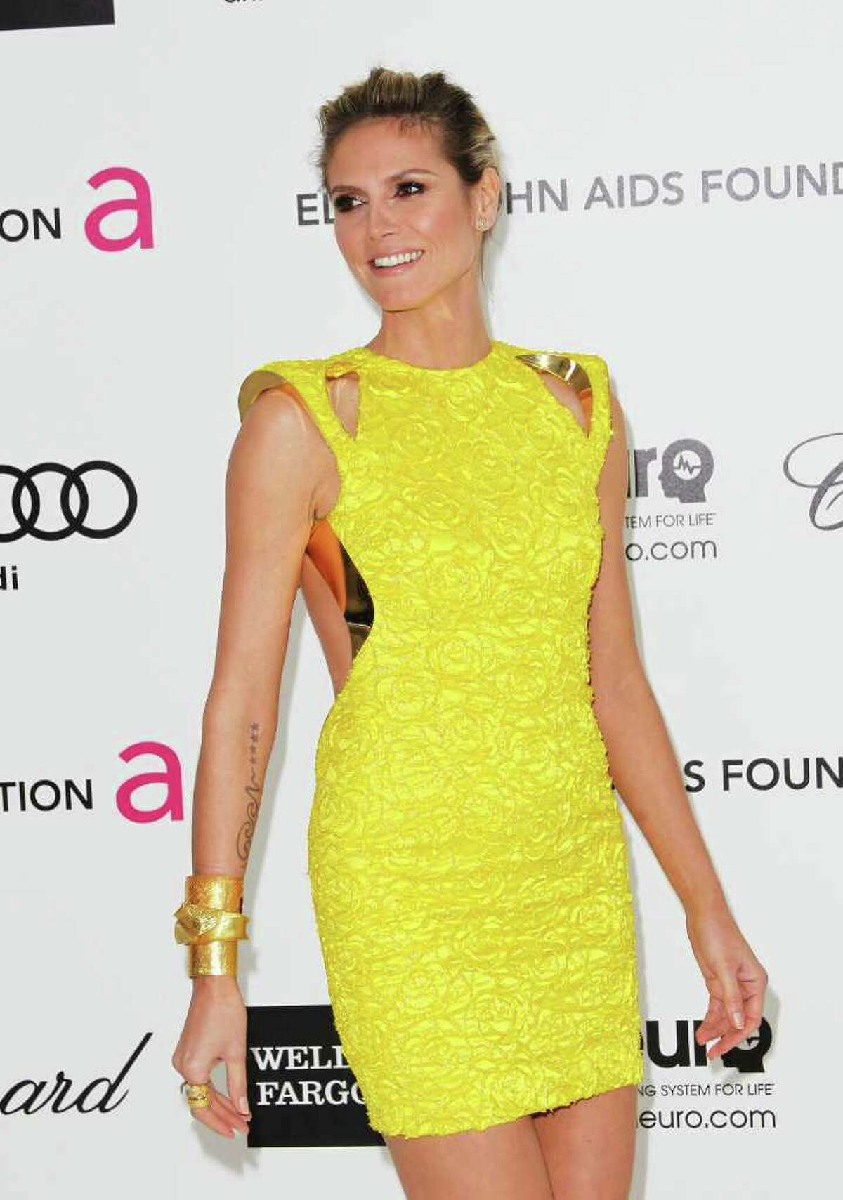 TV Personality Heidi Klum arrives at the 20th Annual Elton John AIDS Foundation's Oscar Viewing Party held at West Hollywood Park on February 26, 2012 in West Hollywood, California.
