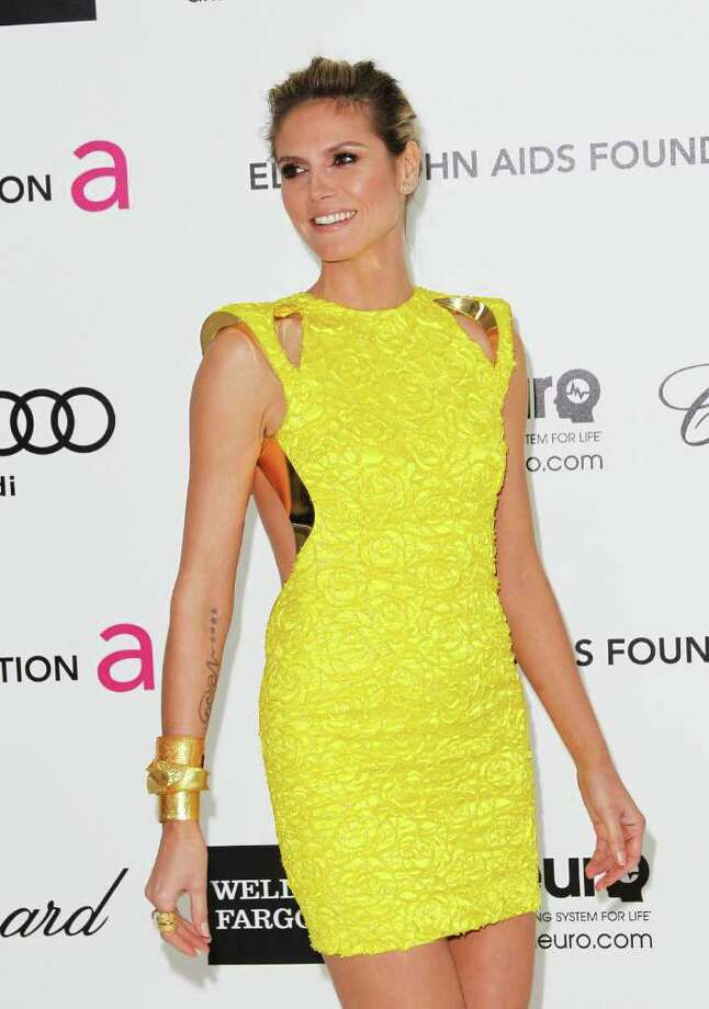 TV Personality Heidi Klum arrives at the 20th Annual Elton John AIDS Foundation's Oscar Viewing Party held at West Hollywood Park on February 26, 2012 in West Hollywood, California. Photo: Frederick M. Brown, Getty / 2012 Getty Images