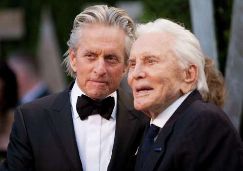 Michael Douglas (L) greets his father Kirk Douglas on the carpet as they arrive at the Vanity Fair Oscar Party, for the 84th Annual Academy Awards, at the Sunset Tower on February 26, 2012 in West Hollywood, California. AFP PHOTO / ADRIAN SANCHEZ-GONZALEZ Photo: ADRIAN SANCHEZ-GONZALEZ, Getty / 2012 AFP