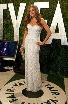 Sofia Vergara arrives at the Vanity Fair Oscar Party, for the 84th Annual Academy Awards, at the Sunset Tower on February 26, 2012 in West Hollywood, California. AFP PHOTO / ADRIAN SANCHEZ-GONZALEZ Photo: ADRIAN SANCHEZ-GONZALEZ, Getty / 2012 AFP