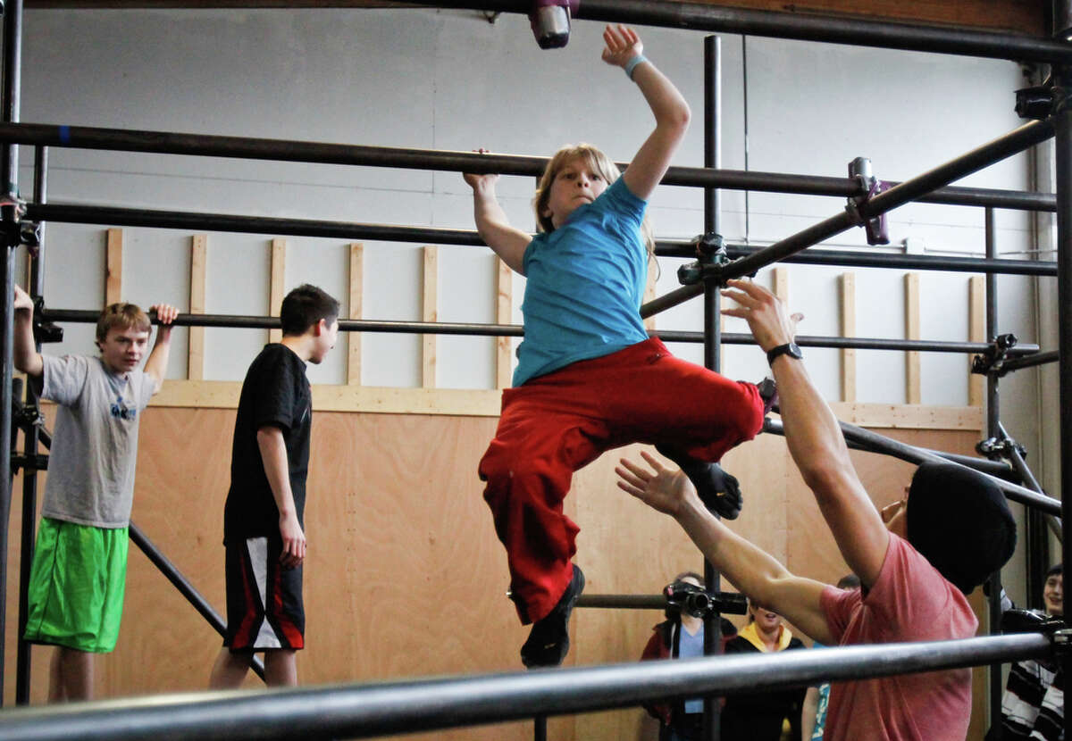 Sophie Denhard, 10, practices different parkour related skills at the Parkour Visions Gym in Seattle on Sunday, Feb. 19, 2012. The gym holds competitions several times a year where children and adults complete various physical challenges and obstacle courses.