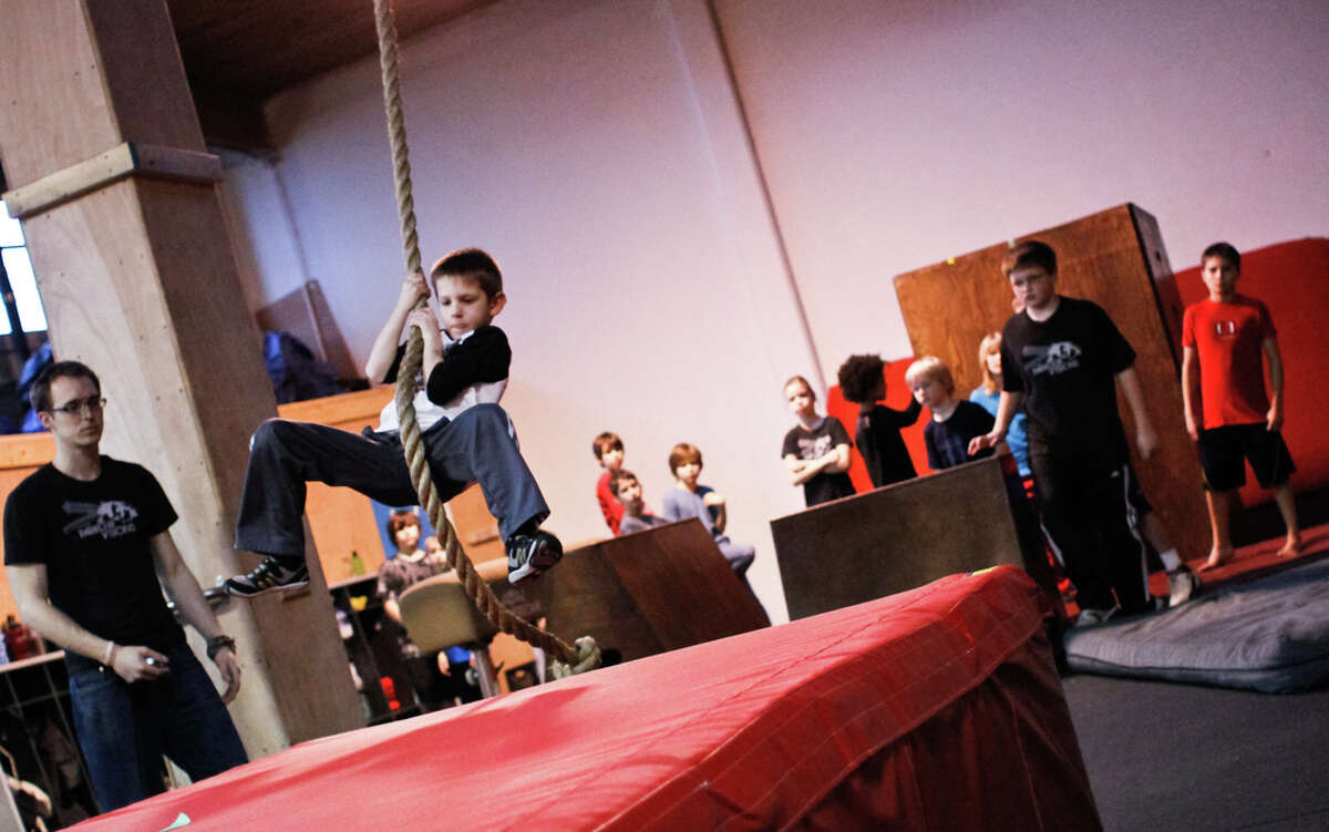Evan Clugston, 7, practices parkour at the Parkour Visions Gym in Seattle on Sunday, Feb. 19, 2012. The gym holds competitions several times a year where children and adults complete various physical challenges.