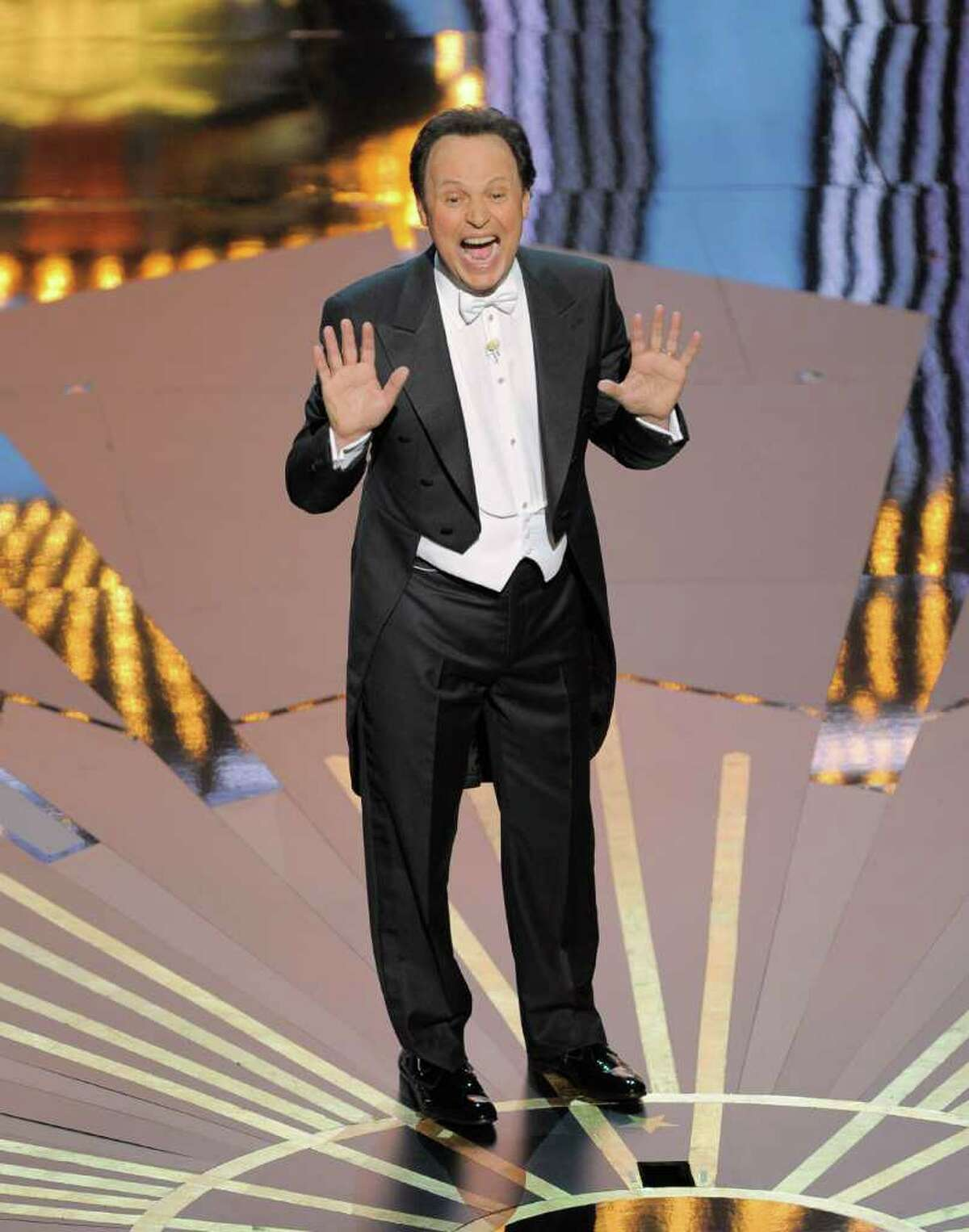 Host Billy Crystal performs onstage during the 84th Academy Awards on Sunday, Feb. 26, 2012, in the Hollywood section of Los Angeles. (AP Photo/Mark J. Terrill)