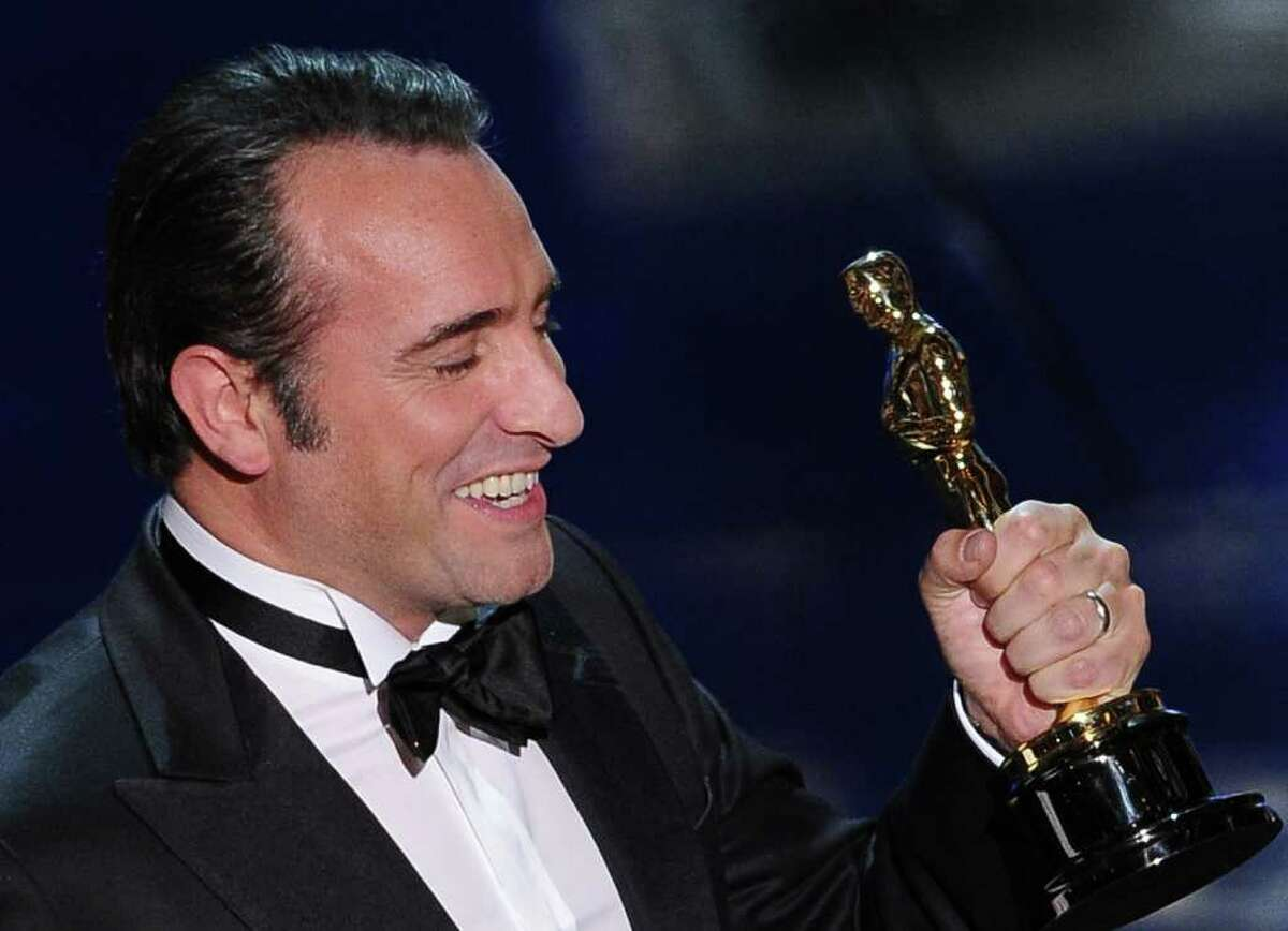 Actor Jean Dujardin reacts as he accepts the Oscar for Best Actor onstage at the 84th Annual Academy Awards on February 26, 2012 in Hollywood, California. AFP PHOTO Robyn BECK (Photo credit should read ROBYN BECK/AFP/Getty Images)