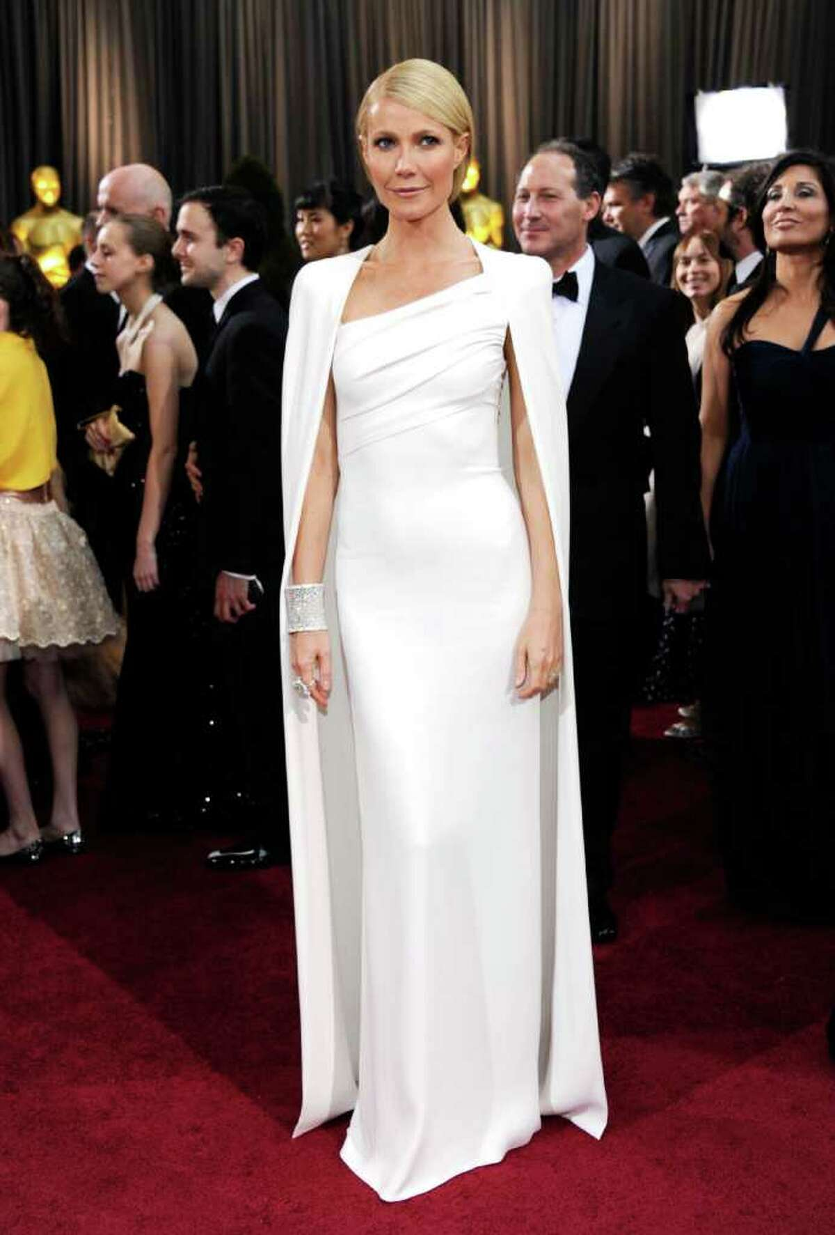 Gwyneth Paltrow donned a white Tom Ford cape dress to mixed reviews.