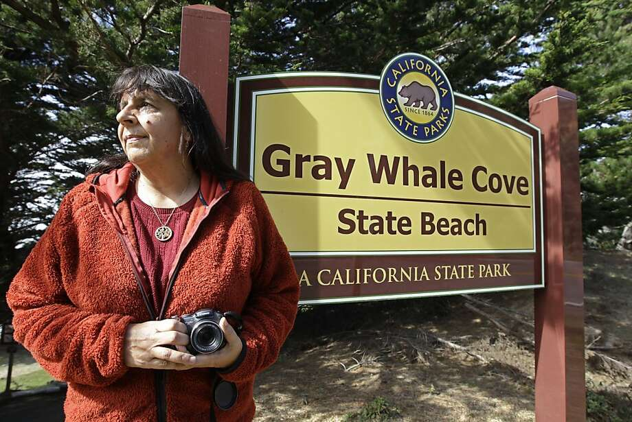 Lucy D'Mot poses at Gray Whale Cove State Beach near Pacifica, Calif., Tuesday, Feb. 21, 2012. Gray Whale Cove is on the list of the Calif. state closure list. She is on a race to visit all doomed parks before the  closure deadline and to tell Californians what they'll be missing. Calif.  Gov. Jerry Brown's proposal to shutter 70 parks by July, 2012 to save $11 million has stirred and inspired saviors who have stepped in with money and sweat to keep some parks open. Photo: Paul Sakuma, Associated Press