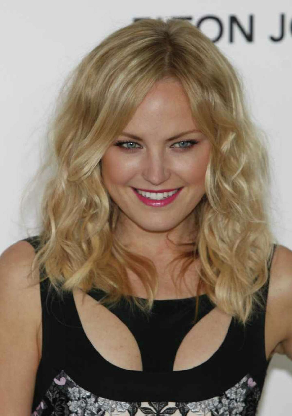 Malin Akerman arrives at the 20th Annual Elton John AIDS Foundation Academy Awards Viewing Party, for the 84th Annual Academy Awards, in the City of West Hollywood Park on February 26, 2012 in West Hollywood, California.