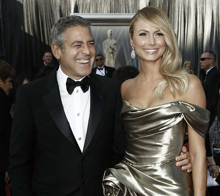 George Clooney, left, and Stacy Keibler arrive before the 84th Academy Awards on Sunday, Feb. 26, 2012, in the Hollywood section of Los Angeles. (AP Photo/Matt Sayles) Photo: Matt Sayles, Associated Press