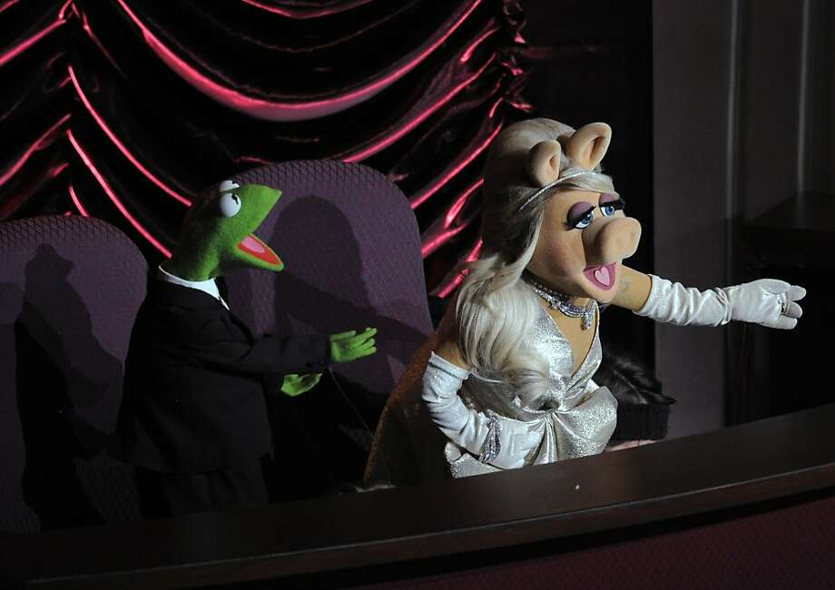 Miss Piggy and Kermit the Frog are seen during the 84th Academy Awards on Feb. 26, 2012, in Hollywood. Photo: Mark J. Terrill, Associated Press