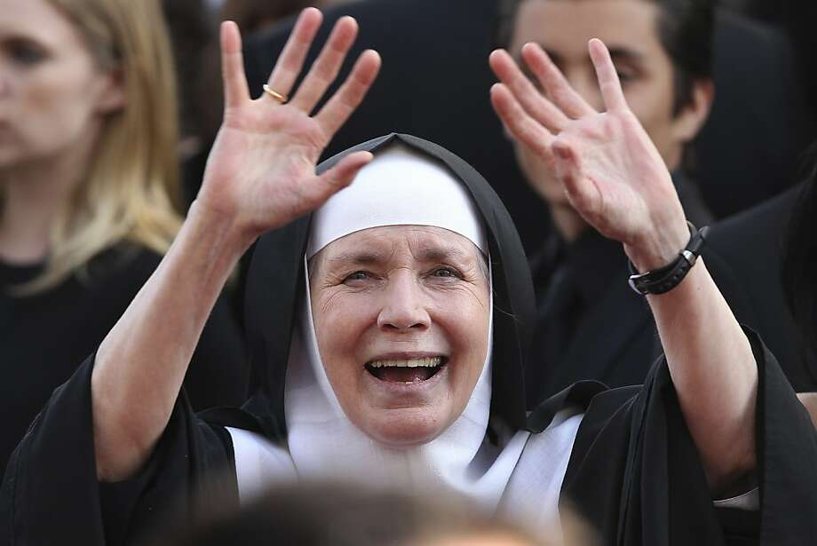 Mother Dolores Hart, shown waving to the crowd at the 2012 Oscars, is the only nun among the voting members of the Academy of Motion Picture Arts and Sciences. Photo: Joel Ryan, Associated Press