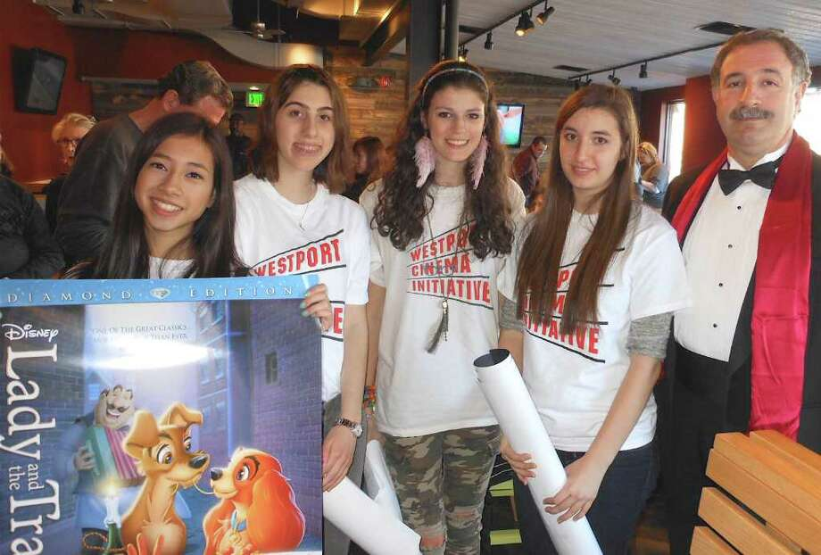 At a pre-Oscars party Sunday at Shake Shack, Staples High School  volunteers with state Rep. Jonathan Steinberg, president of the Westport Cinema Initiative's board. Photo: Mike Lauterborn / Westport News contributed