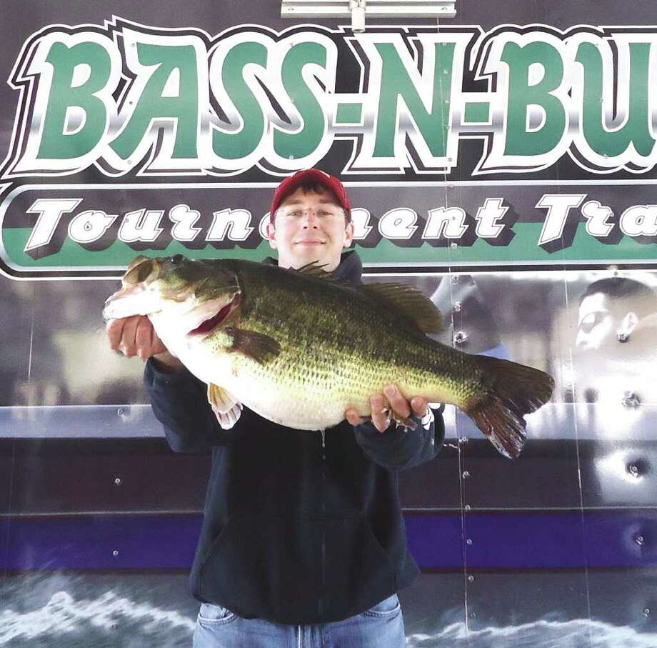 Ryan Pinkson holds up his 14.62 lbs sharelunker; he took home first place for a total weight of 36.06 lbs and big bass for his sharelunker Photo: Jodie Warner