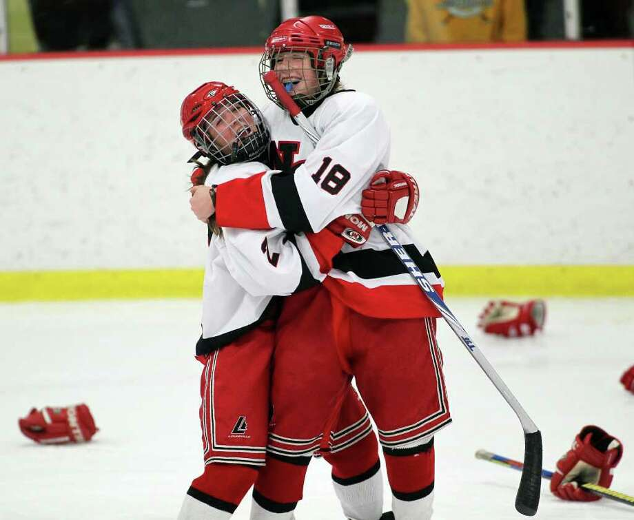New Canaan High School hockey players Lexy Jones and Kyla Persky celebrate their 8-0 FCIAC win over Greenwich on Saturday, Feb. 25, 2012 at Terry Conners Rink in Stamford, Conn. The Rams dominated the game completing a nearly perfect season. Photo: J. Gregory Raymond / J. Gregory Raymond / Stamford Advocate Freelance