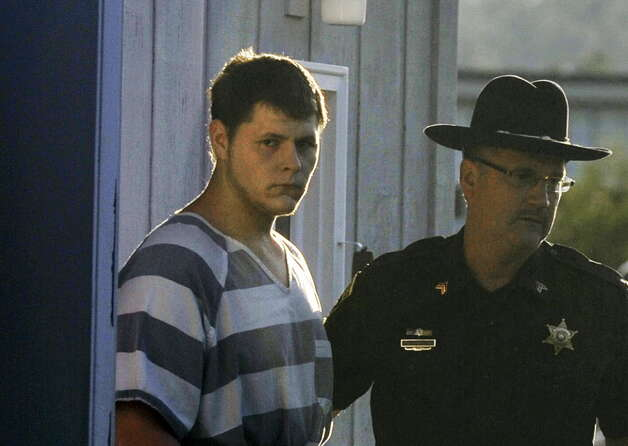 Matthew Slocum is led out of White Creek Town Court in White Creek, N.Y. following an arraignment hearing on Thursday, July 14, 2011. Slocum was arraigned Thursday evening on arson and murder charges after the fiery deaths of his mother, stepfather and stepbrother at their home and an extensive manhunt for him. (AP Photo/The Post-Star, Aaron Eisenhauer)