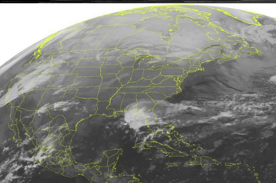 This NOAA satellite image taken Monday, Feb. 27, 2012 at 12:45 a.m. EST shows cloud cover over parts of the Upper Mississippi Valley and the Upper Great Lakes as a storm system over the region kicks up snow in northern Minnesota, northern Wisconsin, and the Upper Peninsula of Michigan.  To the southeast,  showers and periods of heavy rain continue in northern Florida.  (AP PHOTO/WEATHER UNDERGROUND) / WEATHER UNDERGROUND
