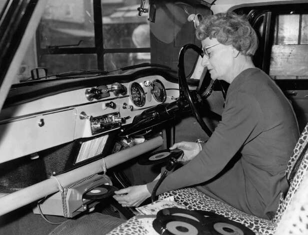 Here's another car-mounted record player, shown in 1960. Is that a bungie cord holding it on? Photo: Fox Photos, Getty Images / Hulton Archive