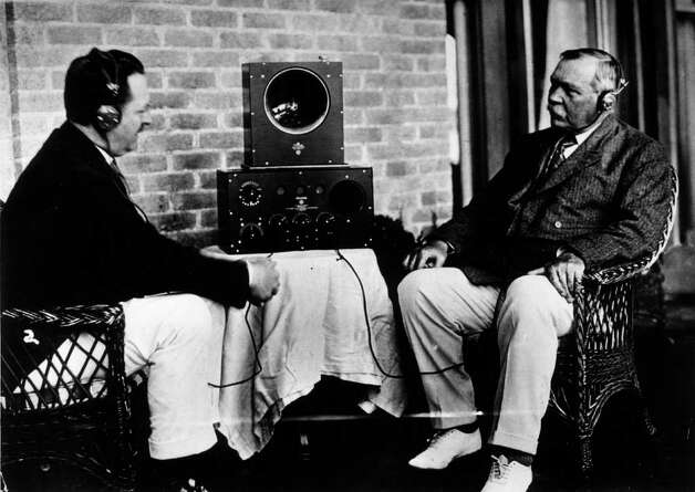 Here's a photo of Scottish writer Sir Arthur Conan Doyle (right) and a friend listening to a radio in 1922. Photo: General Photographic Agency, Getty Images / Hulton Archive