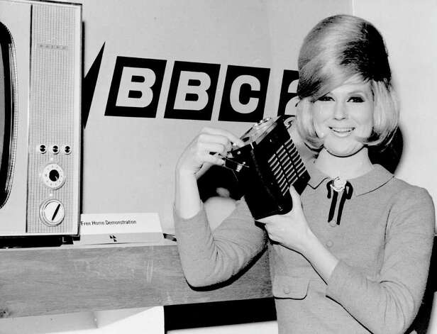 Radios were getting smaller, too. Here's singer Dusty Springfield with the Baird transistor radio presented to her on March 4, 1964 at London's Ideal Home Exhibition. Photo: Fox Photos, Getty Images / Hulton Archive