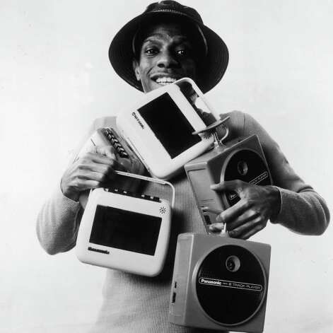 "Here, actor Jimmie Walker poses as ""Good Times"" character ""J. J."" with five portable 8-track players. The tapes proved prone to failure, however, and cassettes won the day. Photo: Hulton Archive, Getty Images / 2004 Getty Images"