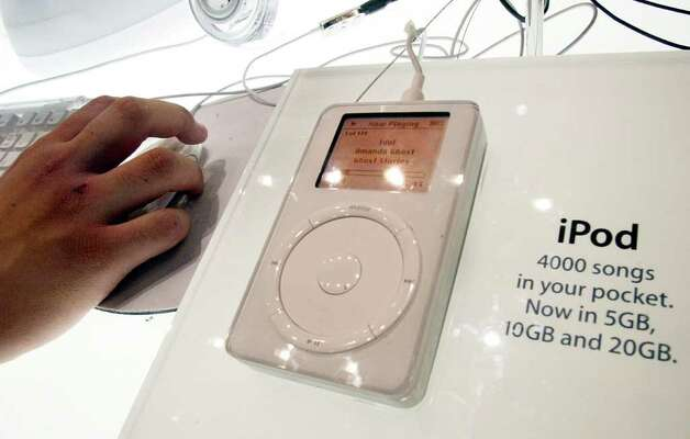 Apple figured out how to popularize MP3 players with the iPod, announced in 2001. This 20 GB version is seen at Macworld Conference and Expo on July 17, 2002 in New York. Photo: Mario Tama, Getty Images / 2002 Getty Images